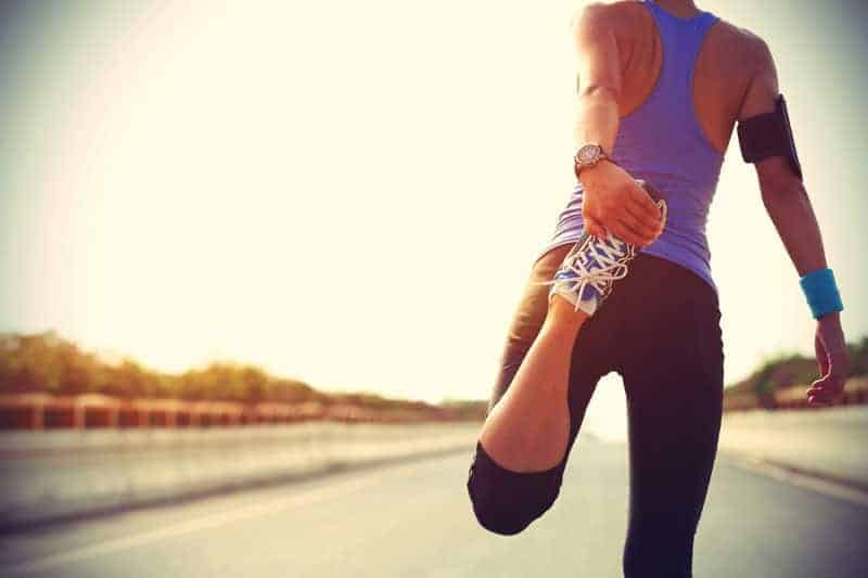 Woman stretching before she goes for a run