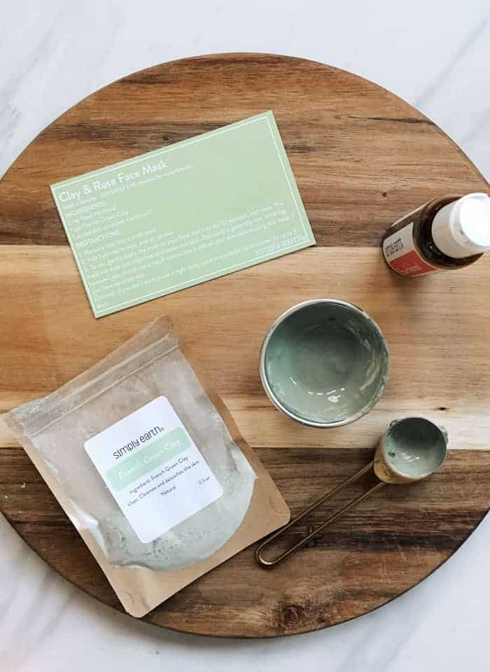Items from essential oil subscription box lying on wooden cutting board