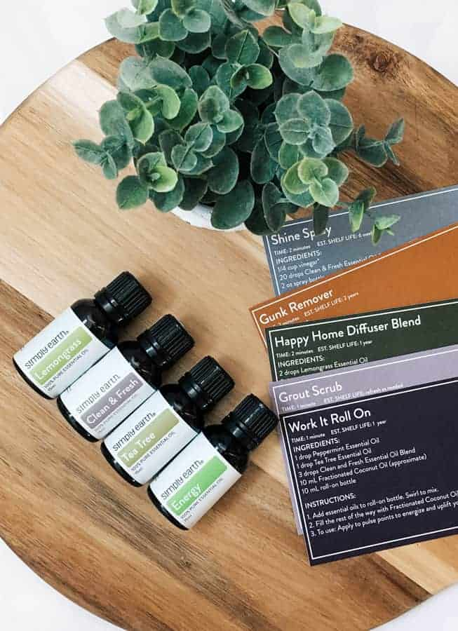 Simply Earth Essential Oils next to plant