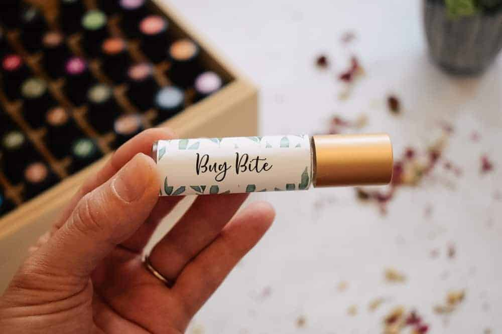 Hand holding bug bite essential oil roller blend