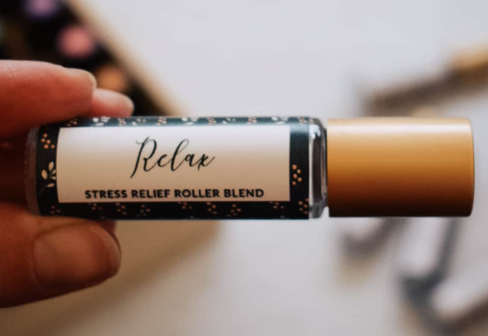 person holding stress relief roller blend