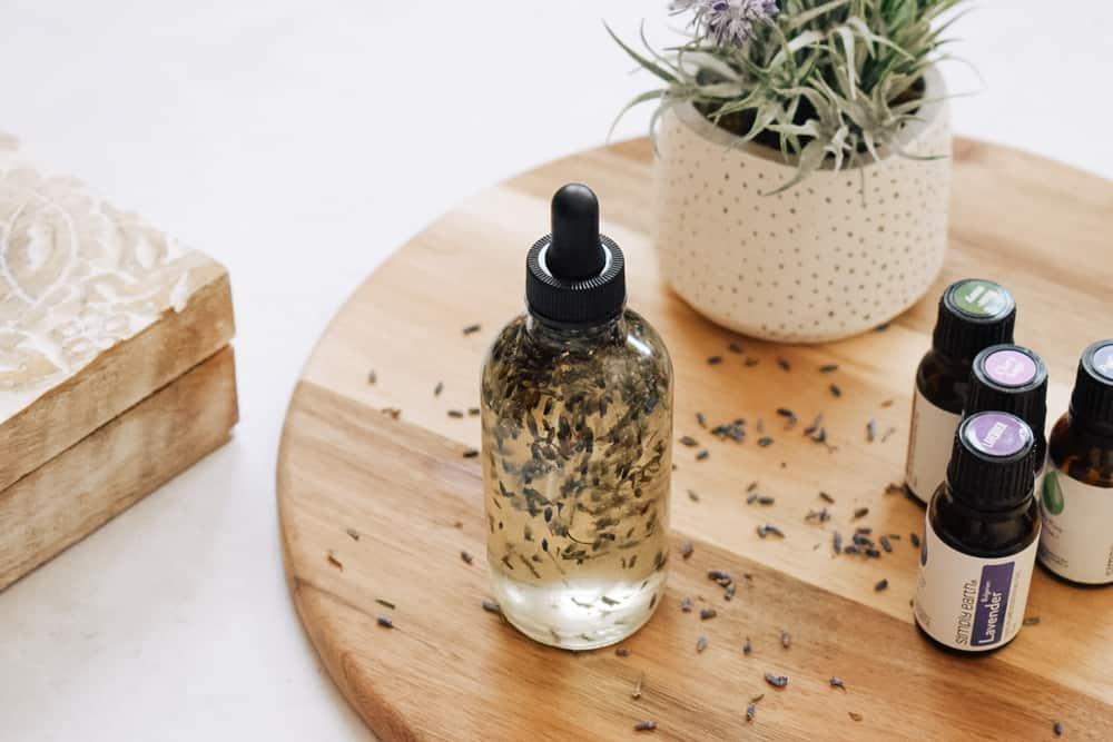 diy hair growth oil sitting on cutting board