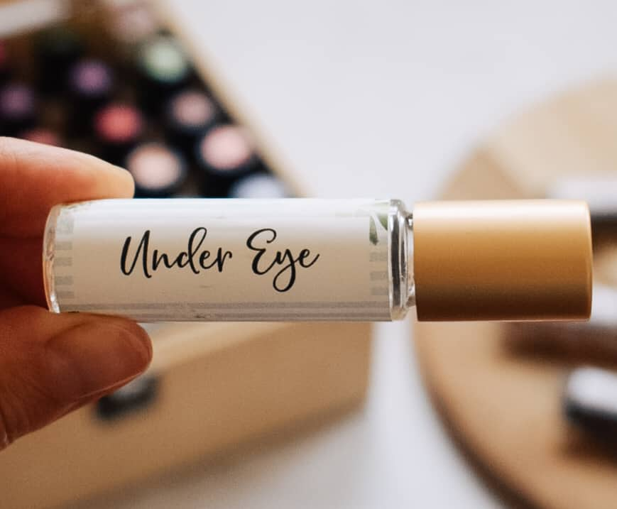 person holding diy under eye roller blend