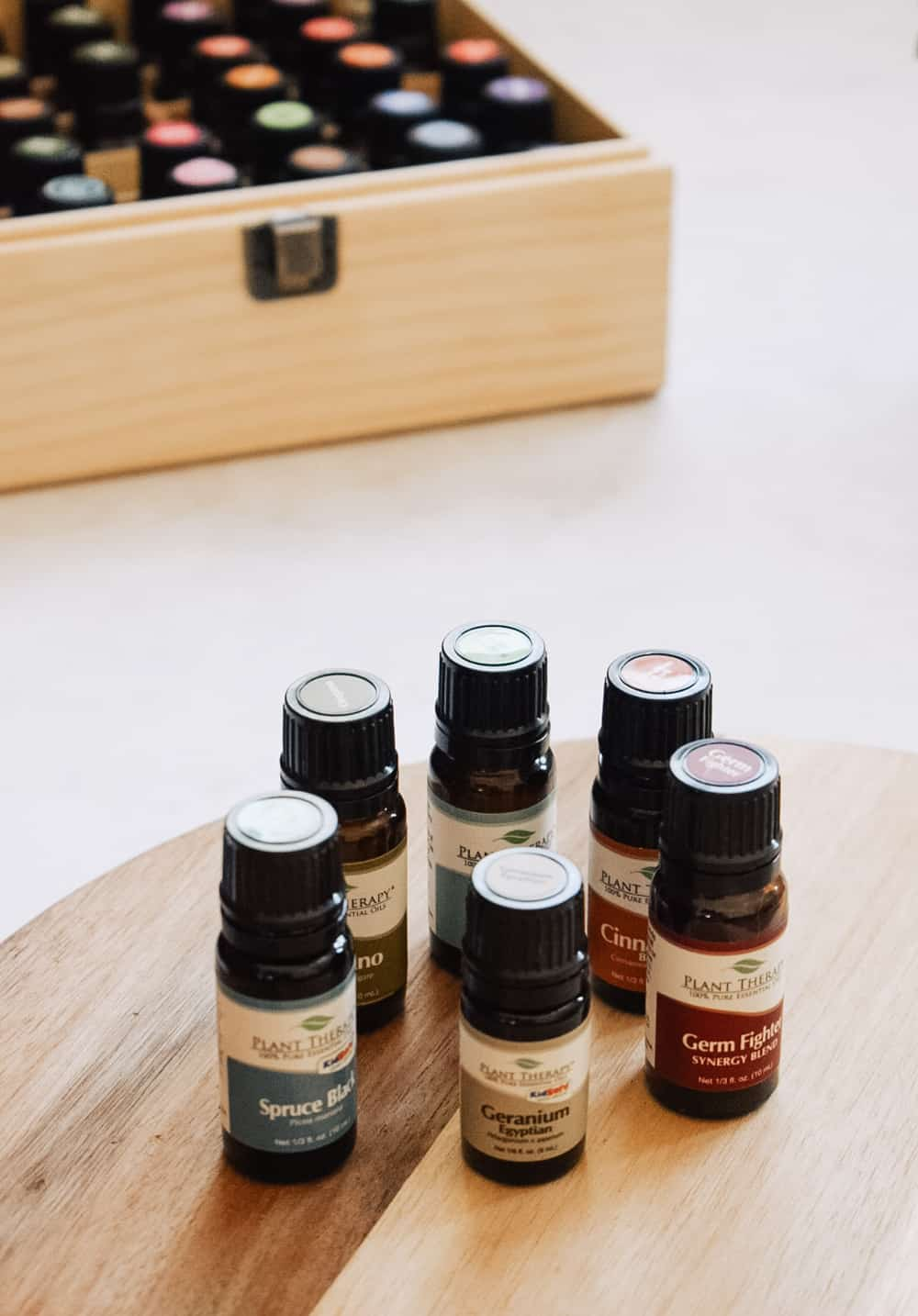 Plant therapy essential oils review lying next to essential oil storage box.