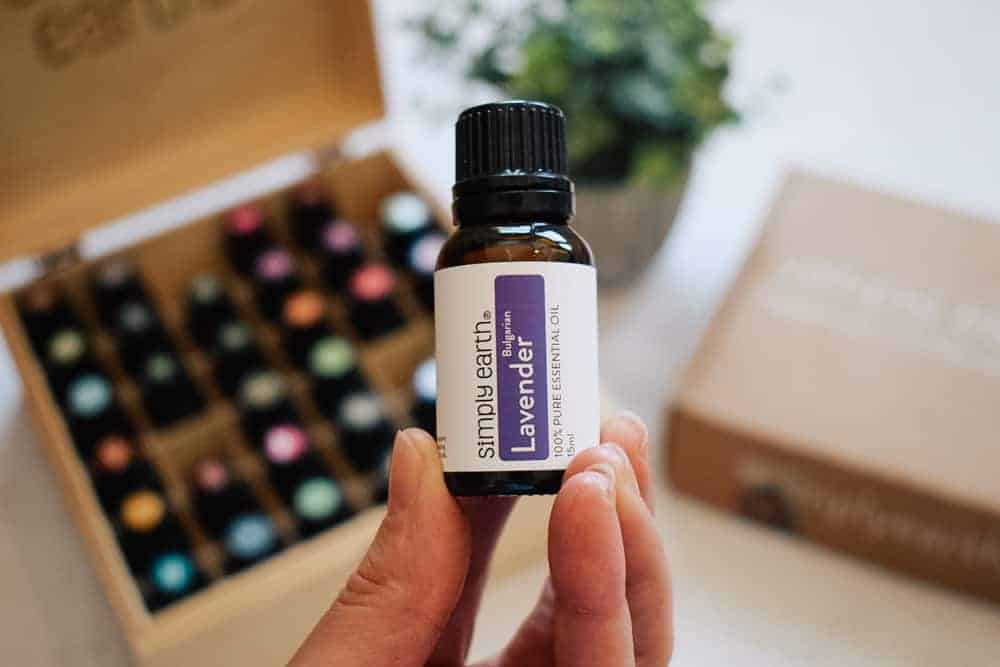woman holding Simply Earth lavender essential oil