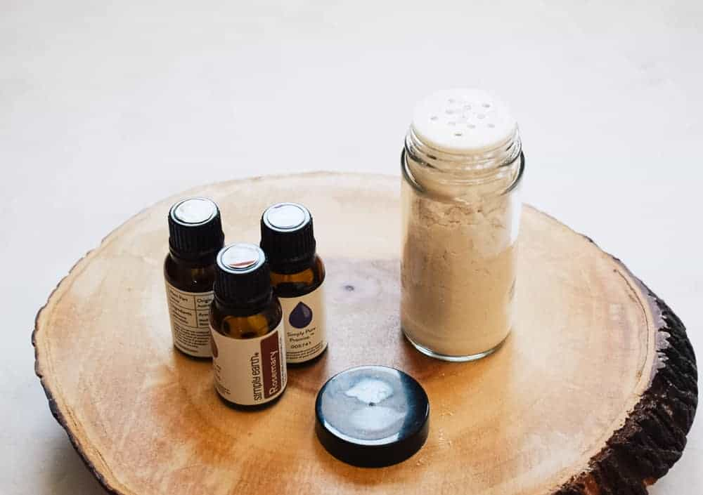 DIY dry shampoo next to Simply Earth essential oils