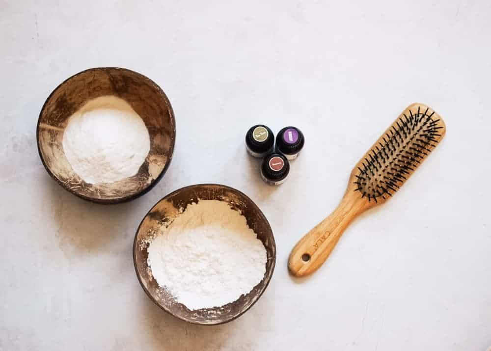 DIY dry shampoo ingredients next to hairbrush