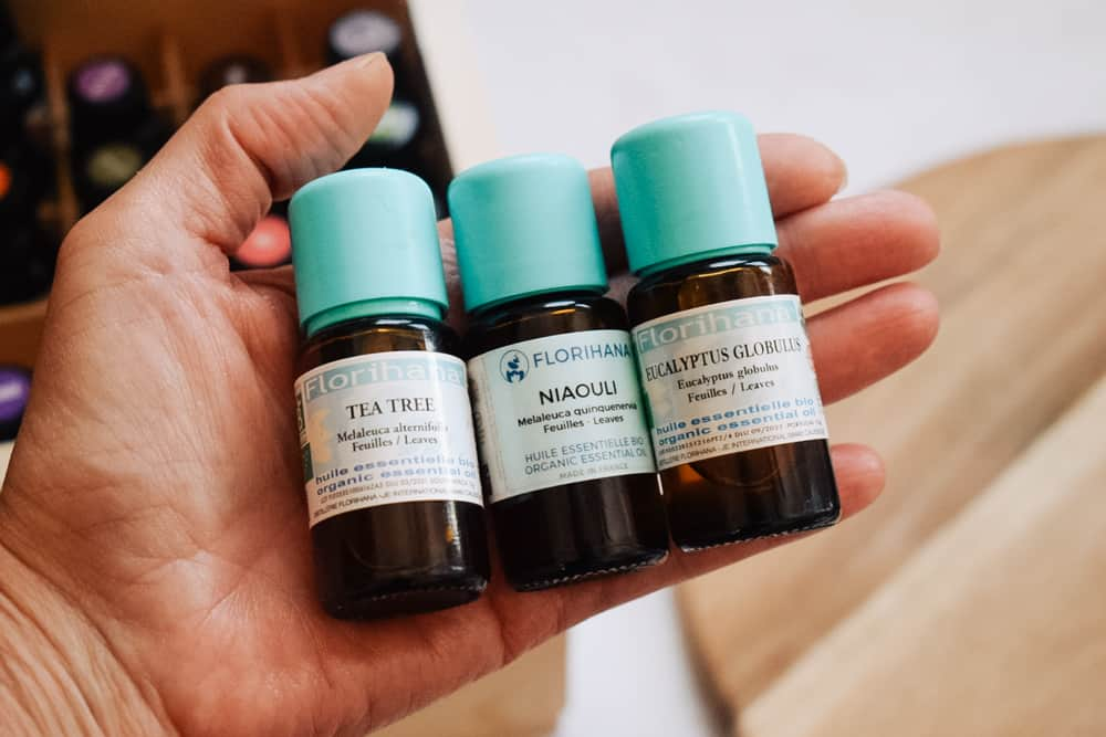 Person holding Florihana Essential oils in their hand