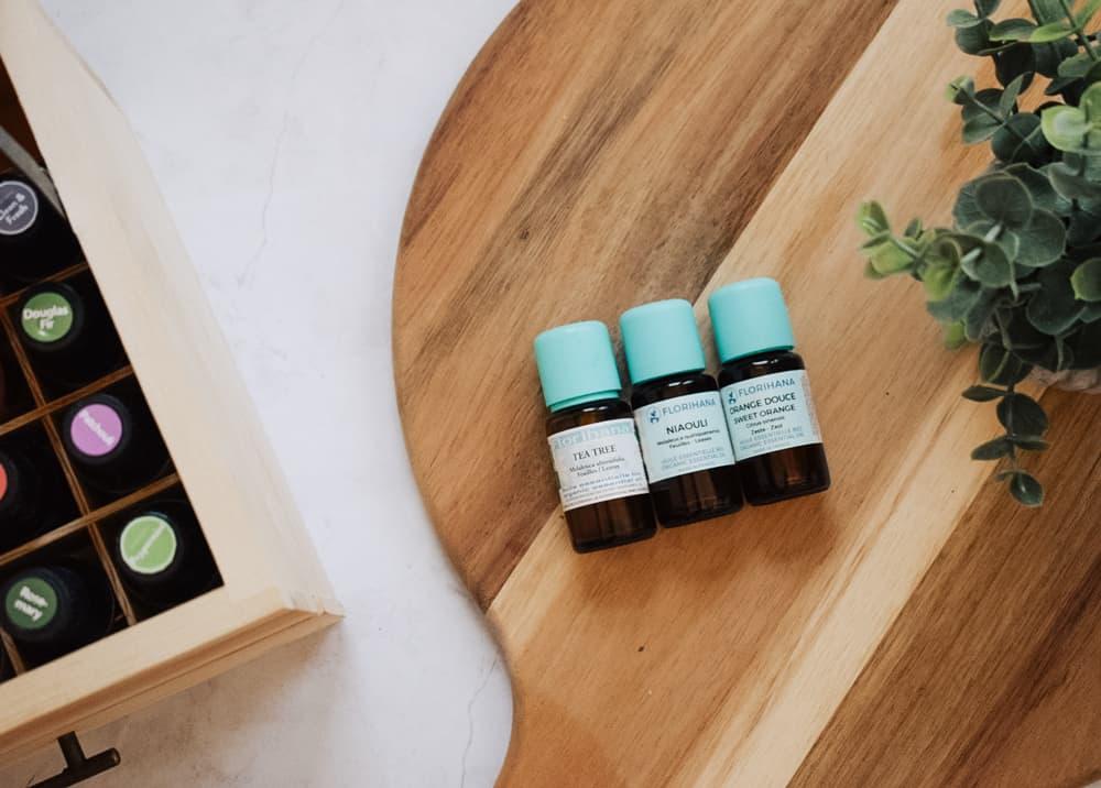 Florihana Essential Oils lying on cutting board