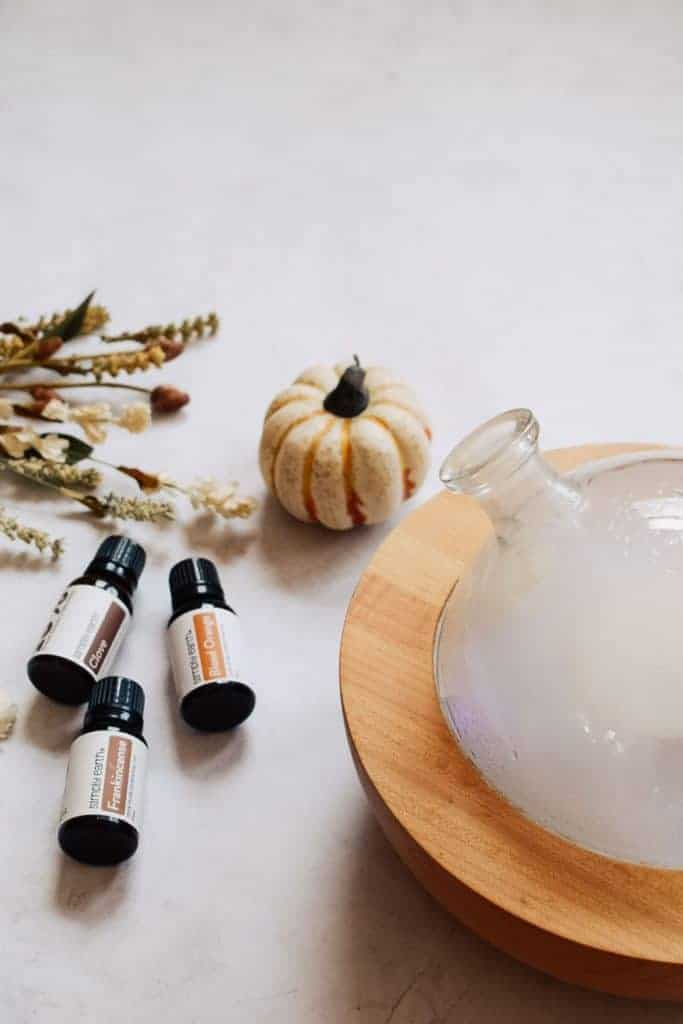Fall essential oils next to essential oil diffuser.