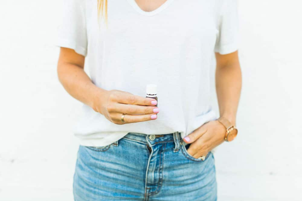 lady holding essential oil bottle