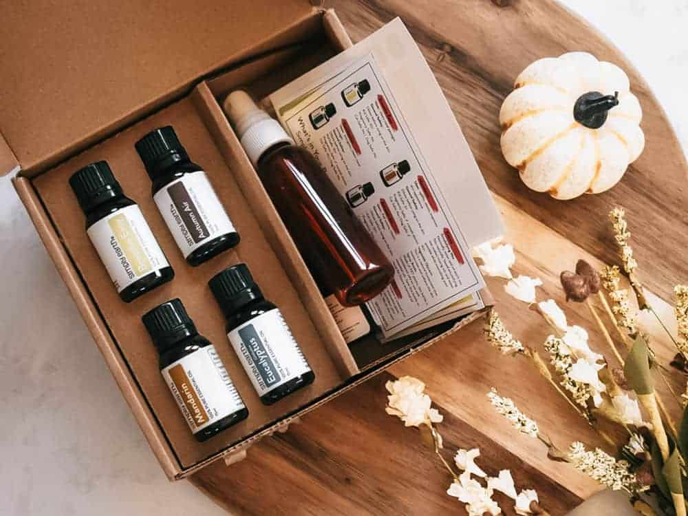 Simply Earth October 2020 Recipe Box sitting on cutting board next to small pumpkin and fall foliage