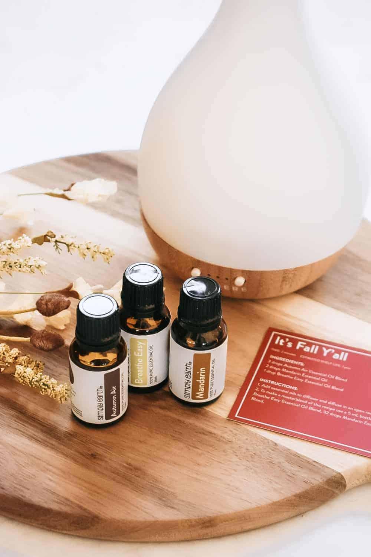 Essential oils sitting next to essential oil diffuser