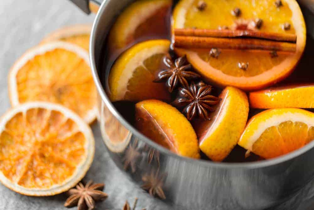 fall simmering pot filled with oranges and cinnamon sticks to make your home smell like fall
