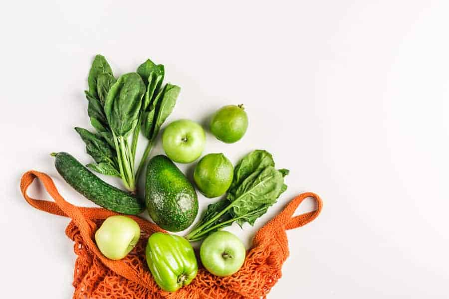 orange bag of green vegetables and fruits