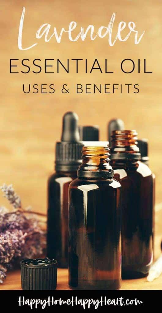 Lavender essential oil bottles sitting on wood table