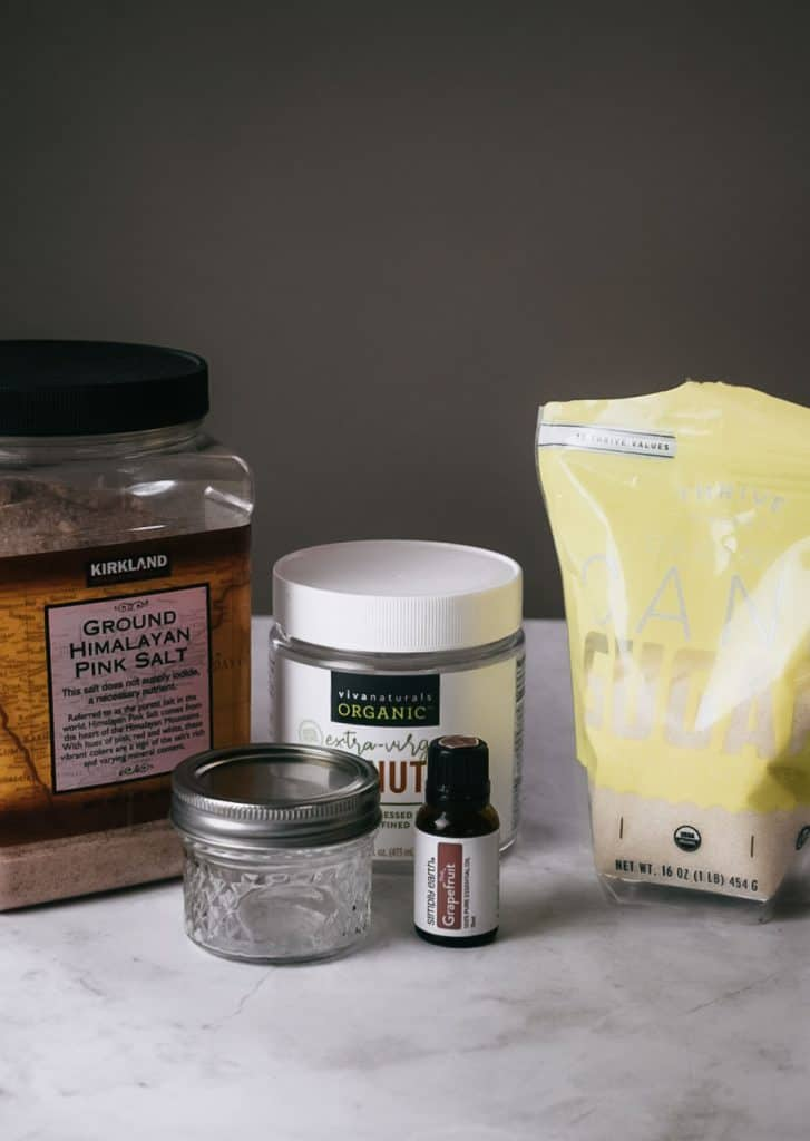 Ingredients for homemade grapefruit body scrub sitting on counter.