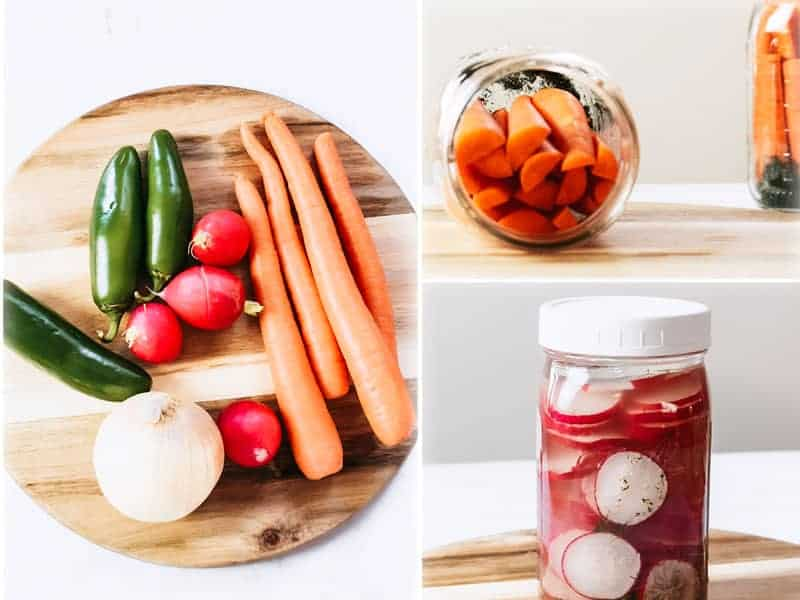 Fermented vegetables in jars on counter.