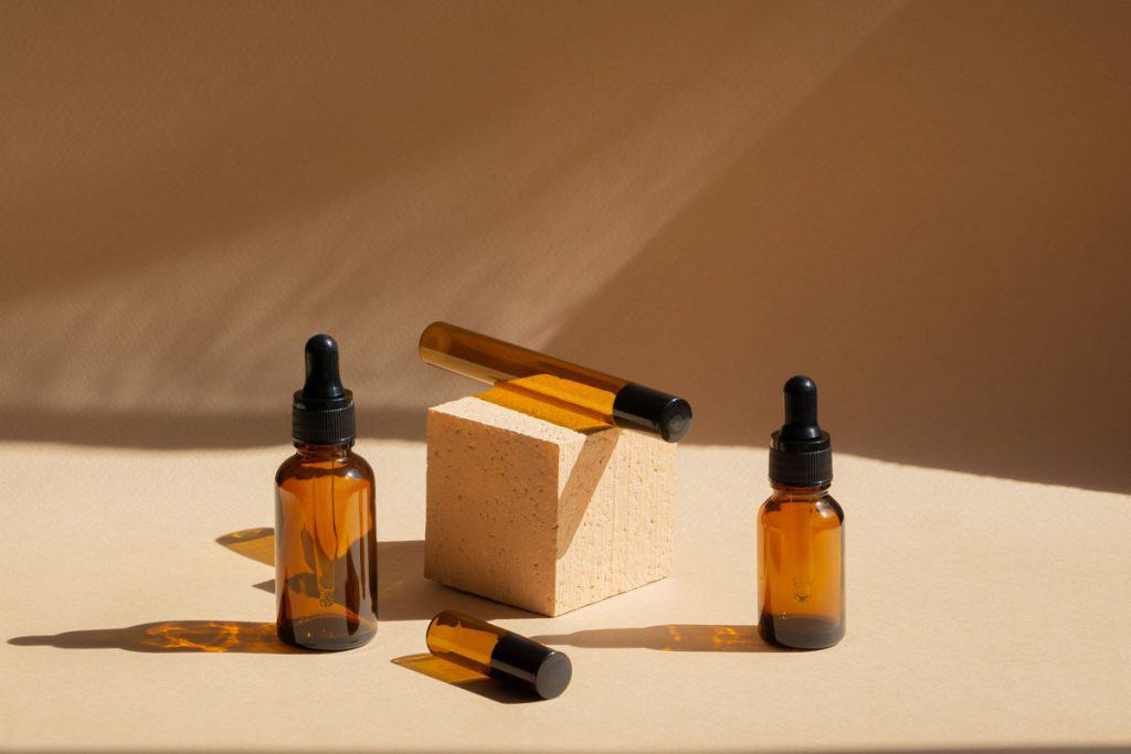 Glass essential oil bottles sitting on counter
