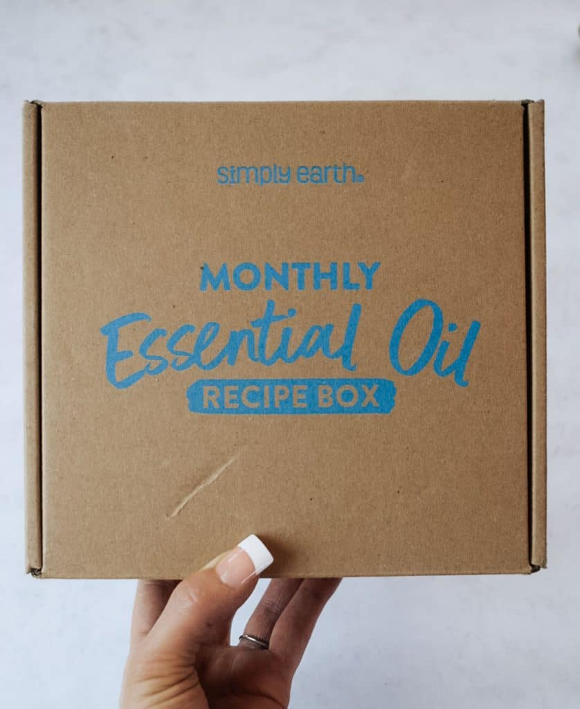 Person holding Simply Earth September 2021 box.